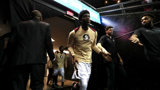 FSU's Terance Mann runs out on to the court for their game against Virginia at the Tucker Civic Center on Wednesday, Feb. 7, 2018.