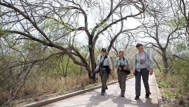 Birders Madeleine Sandefur, Renee Rubin and Joyce Hamilton walk through the Santa Ana National Wildlife Refuge in Alamo, Texas.