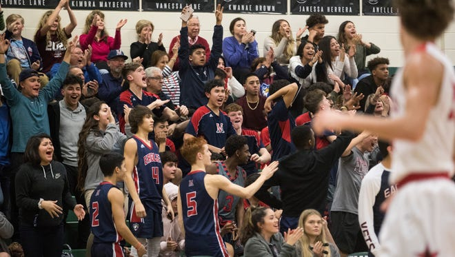 Veterans Memorial fans cheer during the District 30-5A championship game Tuesday, Feb. 13, 2018 at King High School.