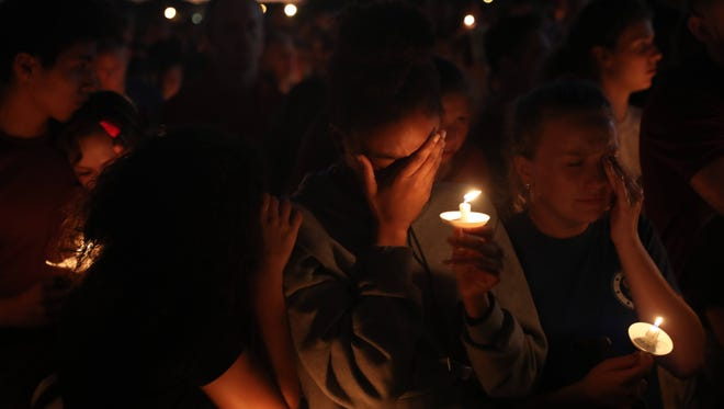 Mourners attend a candlelight vigil for those slain and injured in a mass shooting at Marjory Stoneman Douglas High School at the Parkland, Fl,  Amphitheatre on Thursday 2/15/2018. Thousands were in attendance.