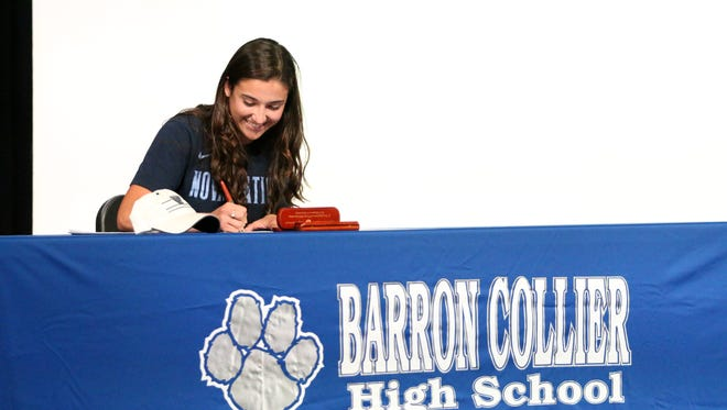 Senior Sierra Rincon signs her letter of intent to play soccer at Villanova during Barron Collier High School's signing ceremony on Thursday, Feb. 15, 2018.