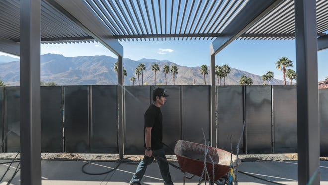 Workers busy putting the last touches on the Steel and Glass House 2018, the last house in Palm Springs designed by Donald Wexler. This will be one of the feature house for this years Modernism Week. Photo taken on Thursday, February 15, 2018.