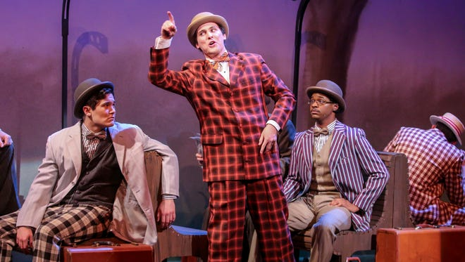 """Portraying a salesman, actor Mason St. Germain, center, rehearses a scene from """"The Music Man"""" on Wednesday, Feb. 14, 2018 at the University of West Florida's Center for Fine and Performing Arts."""