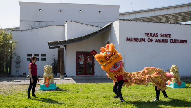 Lili Wang (from left), Yalee Shih, and Peidong Sun practice their routine on Thursday, Feb. 15, 2017 at the Texas State Museum of Asian Cultures for the Taste of Asia and Lunar New Year Celebration on Saturday.
