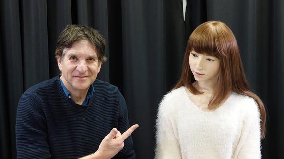 Jefferson Graham and the robot Erica. Erato Ishiguro Symbiotic Human-Robot Interaction Project