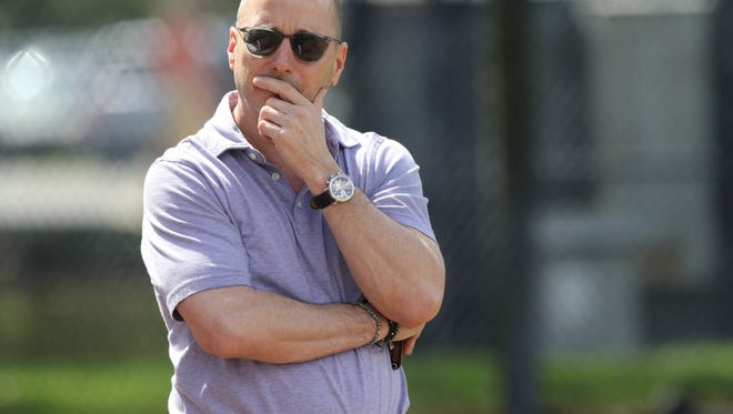 Yankee general manager Brian Cashman watches his team practice.
