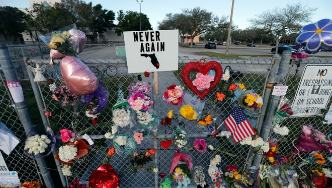 A makeshift memorial is seen outside the Marjory Stoneman Douglas High School in Parkland, Fla., where 17 students and faculty were killed in a mass shooting last week.
