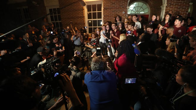 Students from Stoneman Douglas in Broward County, where seventeen people were killed and fifteen more injured by shooter Nikolas Cruz last week, are greeted at Leon High School Tuesday night.