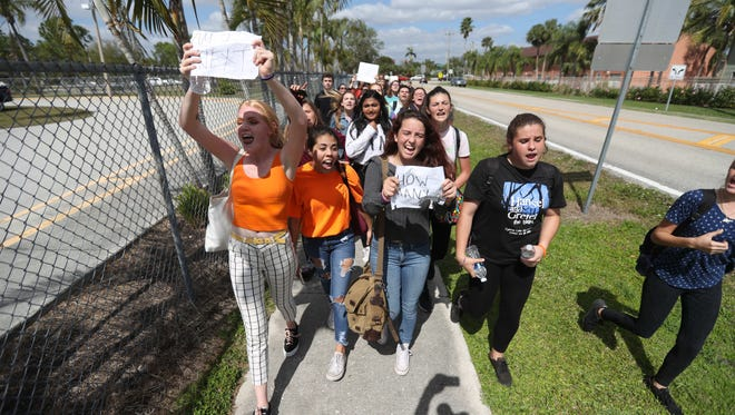 Cypress Lake High School students walked out class on Wednesday to protest gun violence in schools. Several hundred of them gathered at the corner of Panther Lane and Cypress Lake Drive to protest. They were one of  several high schools in the area that protested.