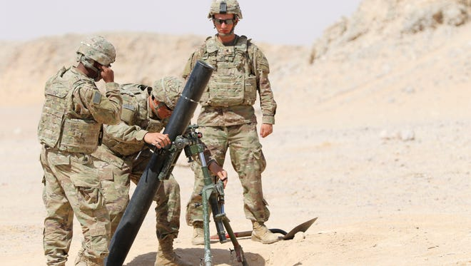Infantrymen with 1st Battalion, 35th Armored Regiment fire their mortar during the Inferno Creek exercise in Oman.