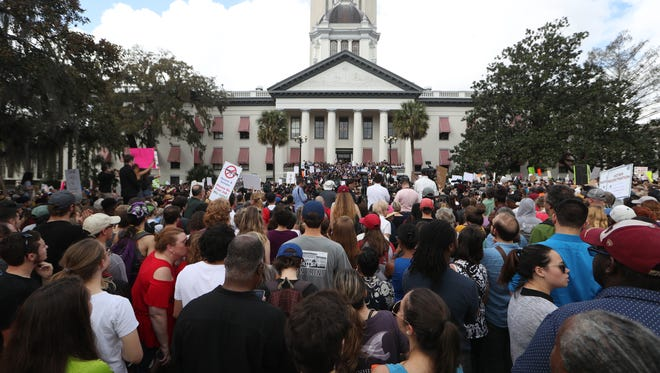 A rally against gun violence in Florida culminates at the steps of the Old Capitol in Tallahassee as Marjory Stoneman Douglas High School survivors lead the way on Wednesday, Feb. 21, 2018.