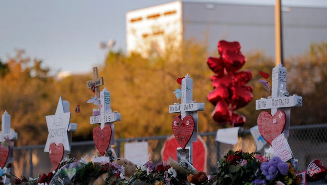 A makeshift memorial is seen outside Marjory Stoneman Douglas High School in Florida, where 17 students and faculty were killed in a mass shooting.