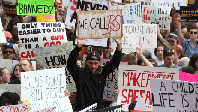 A rally against gun violence in Florida culminates at the steps of the Old Capitol in Tallahassee as Stoneman Douglas survivors lead the way on Wednesday, Feb. 21.