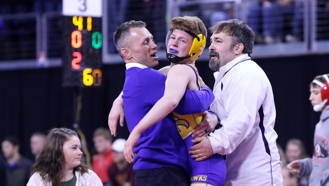Braden Sehr of Canton celebrates with coaches Jeremy Ask (L) and Head Coach Jeremy Swenson after winning the Class B 106 title on Saturday in Sioux Falls.