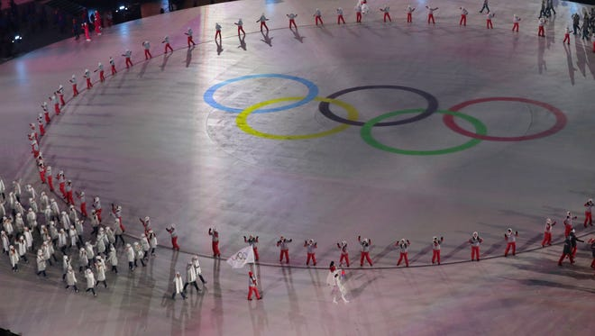 Olympic Athletes from Russia march in under the Olympic flag during the opening ceremony for the Pyeongchang 2018 Olympic Winter Games at Pyeongchang Olympic Stadium on Feb. 9.
