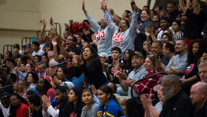 West Oso's fans cheer during the regional quarterfinal game Tuesday Feb. 27, 2018 at Tuloso-Midway High School.