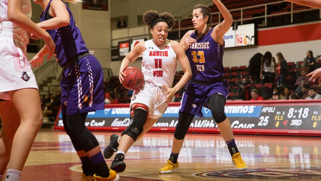 Austin Peay women's basketball forward Brianne Alexander drives to the basket against Tennessee Tech.