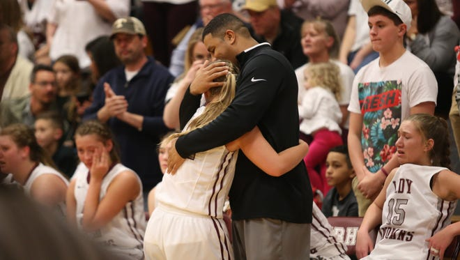 East Robertson coach Kenyatta Perry hugs one of his players during the final seconds of their Class A sectional loss to Summertown on Saturday in Cross Plains.