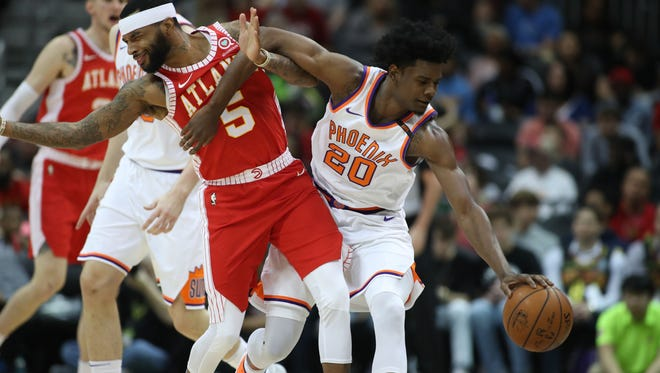 Mar 4, 2018; Atlanta, GA, USA; Phoenix Suns guard Josh Jackson (20) and Atlanta Hawks guard Malcolm Delaney (5) collide as they fight for a loose ball during the second quarter at Philips Arena. Mandatory Credit: Jason Getz-USA TODAY Sports