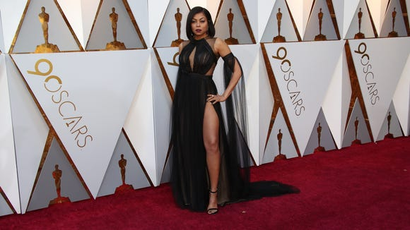 Taraji P. Henson showed off her toned legs in a chiffon Vera Wang gown at the 90th Academy Awards.