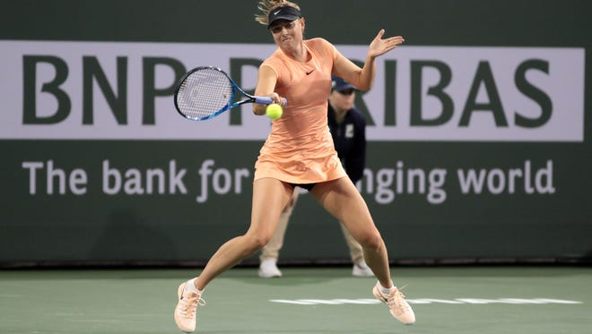 Maria Sharapova, of Russia, returns the ball to Naomi Osaka of Japan on the 1st Wednesday of the BNP Paribas Open on March 7, 2018 in Indian Wells, CA.