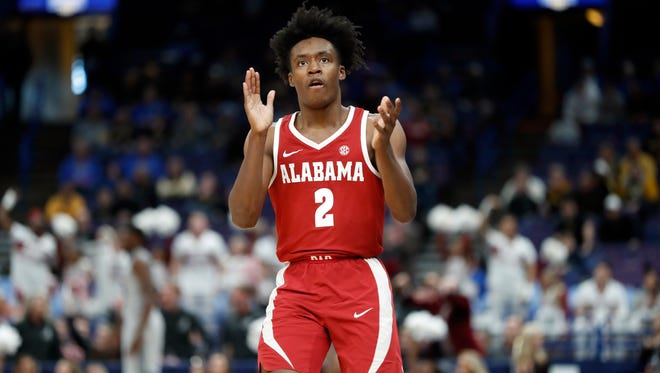 Alabama's Collin Sexton celebrates during the second half in an NCAA college basketball game against Texas A&M at the Southeastern Conference tournament Thursday, March 8, 2018, in St. Louis. Alabama won 71-70.