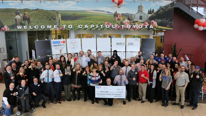 Capitol Auto Group staff present the United Way with a $175,000 donation on Thursday, March 8, 2018.