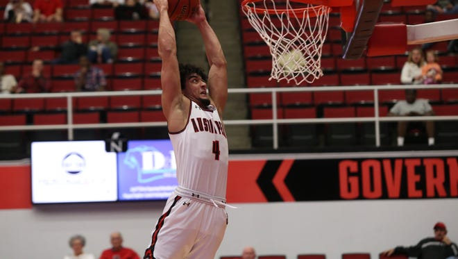 Austin Peay's Dayton Gumm goes up for a dunk against Louisiana-Monroe during their CIT game Thursday at Dunn Center.