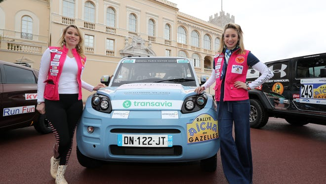 """Jazmin Grace Grimaldi (R) the daughter of Prince's Albert II of Monaco and Swiss actress and model, Kiera Chaplin attend the departure of the """"Rallye des Gazelles"""" on March 17, 2018 in Monaco."""
