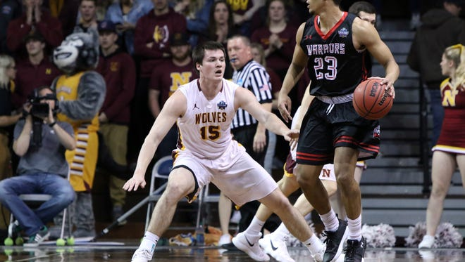 Bo Fries of Northern State applies defensive pressure to Marc Rodriguez of East Stroudsburg during Tuesday's NCAA quarterfinal game at the Pentagon.