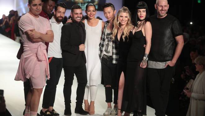 Castell and Project Runway designers Mah-Jing Wong, Viktor Luna, Michael Costello, Margarita Alvarez, Kentaro Kameyama, Laura Kathleen Baker, Candice Cuoco, and Justin Leblanc share the stage at the end of their show at Fashion Week El Paseo Tuesday, March 20, 2017 in Palm Desert.