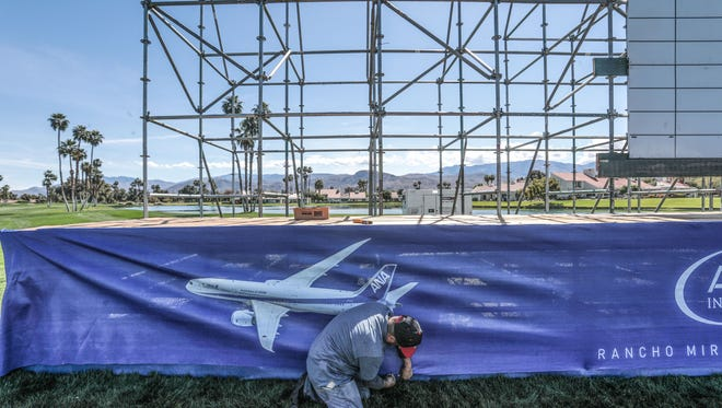 Paul Soler works on a scoreboard on 18  in preparation for the ANA Inspiration LPGA golf tournament next week at the Mission Hills Country Club in Rancho Mirage. Photo taken on Friday, March 23, 2018.