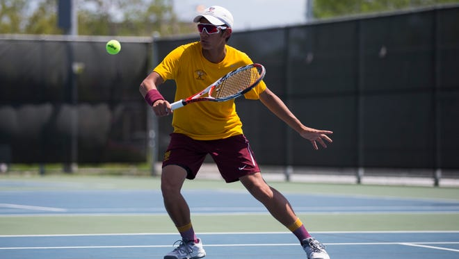 Tuloso-Midway's Samson Garibay hits the ball during the Whataburger Invitational Tennis Tournament Friday, March 23, 2018 at H-E-B Tennis Center.