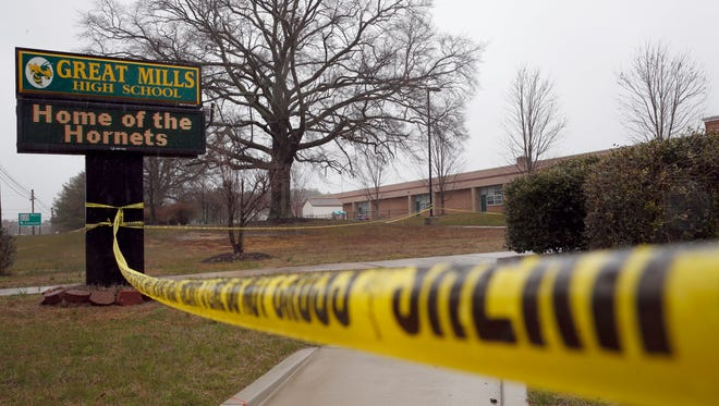 Crime scene tape around Great Mills High School at the scene of a shooting on March 20, 2018. A Maryland Senate panel has approved a measure to create consistent standards for school safety statewide.