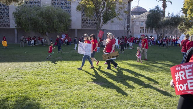 Organizers of Arizona Educators United group announced their demands of Gov. Doug Ducey and the Legislature for education funding during a rally at the Arizona state Capitol on March 28, 2018.