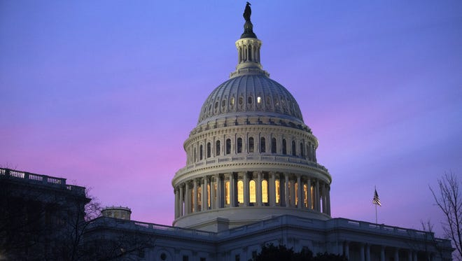Congress has passed a two-week spending bill that averts a government shutdown for now but puts off tough budget decisions until just before Christmas.