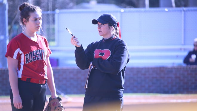 Rossview first-year coach Courtney Elrod (right) talks with one of her players between innings against Clarksville High Wednesday.