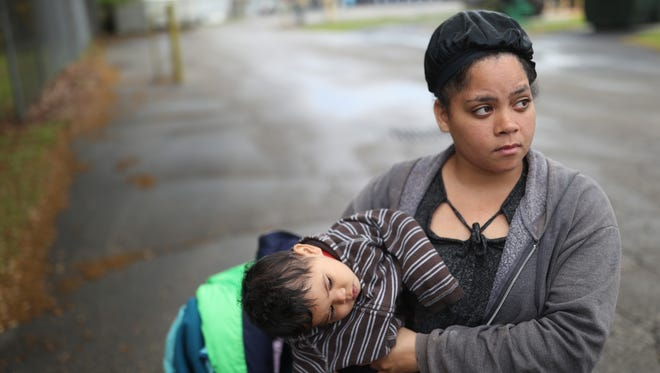 Vanessa Pastoriza holds 10-month-old Zacarias, one of her five children. For the last month, they have stayed at the HOPE Community shelter, where she has complained of unsanitary conditions, pest infestations and discrimination.