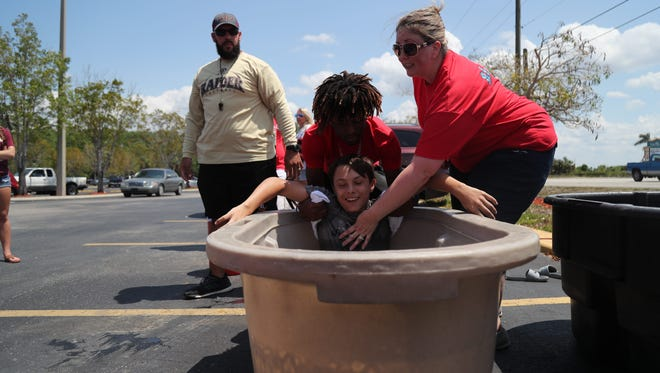 Three techniques to quickly and safely cool down an overheated person were demonstrated during a barbecue dinner fundraiser for the Zach Martin Memorial Foundation on Saturday, April 7, 2018. The fundraiser continues on Sunday until 4 p.m. at the Winn Dixie parking lot on Palm Beach Boulevard in east Fort Myers. All proceeds from the event go toward a scholarship for Certified Athletic Trainers and cooling equipment for local high schools.