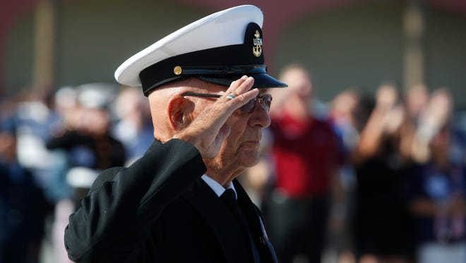 John Easton, a past honoree of the Veterans Expo, salutes the flag at the Riverside County Fair Grounds during the opening of the 8th annual veterans expo on April 7, 2018,