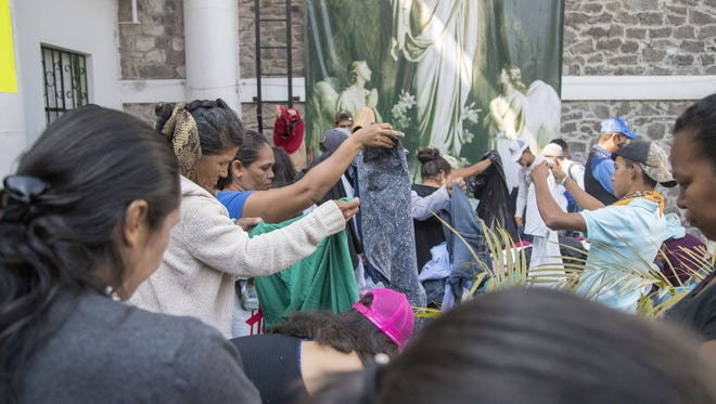 Central American migrants gathered inside and outside a church in Puebla, Mexico, on April 7, 2018, for a caravan that hoped to travel to the U.S. border, drawing the ire of President Trump.