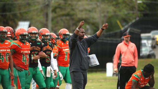 FAMU coach Willie Simmons signals in an offensive play during Sunday's scrimmage.