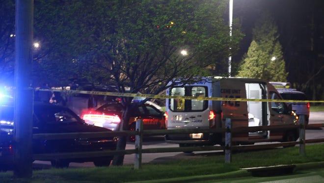 Police investigate a scene of a death near Seven Hills School.