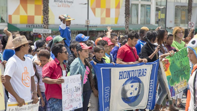 Migrants from Central America walk to Basilica of Our Lady of Guadalupe in Mexico City on April 9, 2018.
