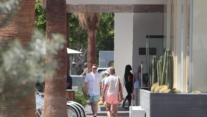 Guests wait for their car at the Kimpton Rowan Palm Springs Hotel on Friday, April 13, 2018. Coachella Valley hotels are busy with guests attending the Coachella Music Festival this weekend.