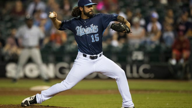 Hook's Ralph Garza pitches in the ninth inning during their season opener against Northwest Arkansas Naturals on Thursday, April 12, 2018 at Whataburger field.