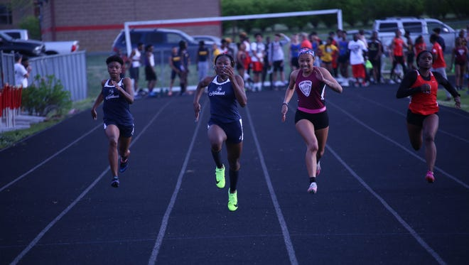 Northeast's Calandra Henry, center, outpaces her competition in the 100-meter dash during a meet at Rossview High School.