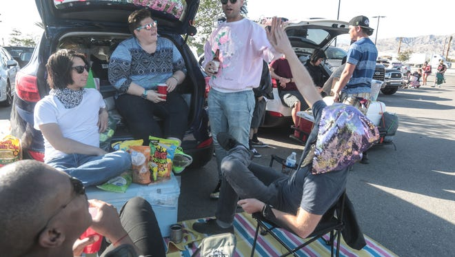 Coachella Music Festival campers hangout at the Walmart parking lot in Indio on Thursday, April 19, 2018. High winds has delayed campers from entering the festival grounds.