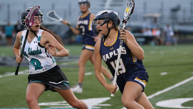 Gulf Coast's Taylor Griffin, left, guards Naples' Sophie Sullinger in the regional girls lacrosse quarterfinal between Gulf Coast and Naples on Thursday, April 26, 2018.