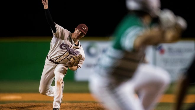 Calallen pitcher Hambleton Oliver throws against King in Game 2 of the District 30-5A championship game at Steve Chapman Field o Friday, April 27, 2018.